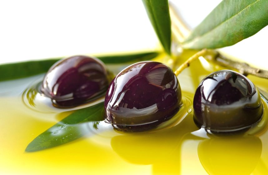 Olives closeup and olive oil