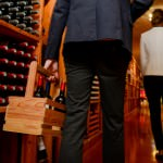 Young couple buying wine in a store